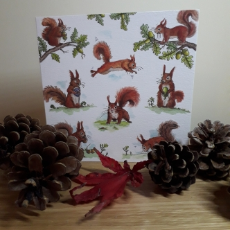 Photo of a greeting card with red squirrels on it
