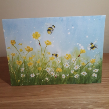 Photo of greeting card of bees and daisies